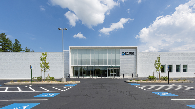 Exterior of large medical building with large parking lot