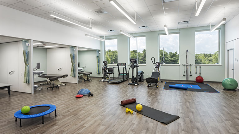 Workout room with ellipticals and mats