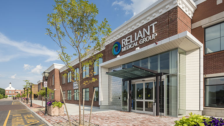 Exterior view of brick building with Reliant Medical Group logo on it