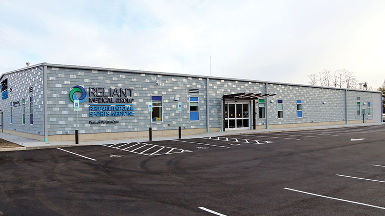 Exterior of a building with Reliant Medical Group Rehab logo on the front