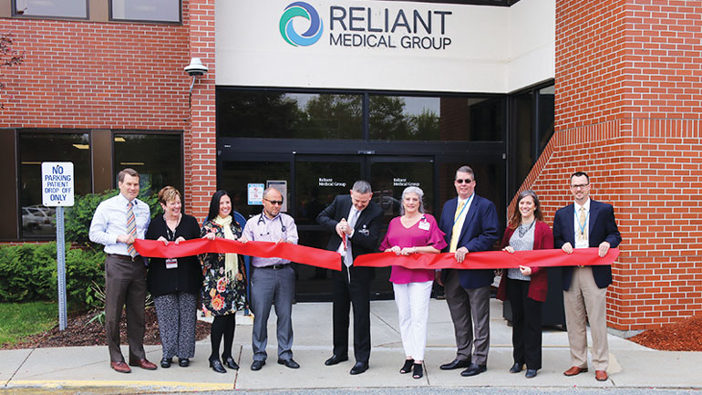 Ribbon cutting outside of Reliant Medical Group building