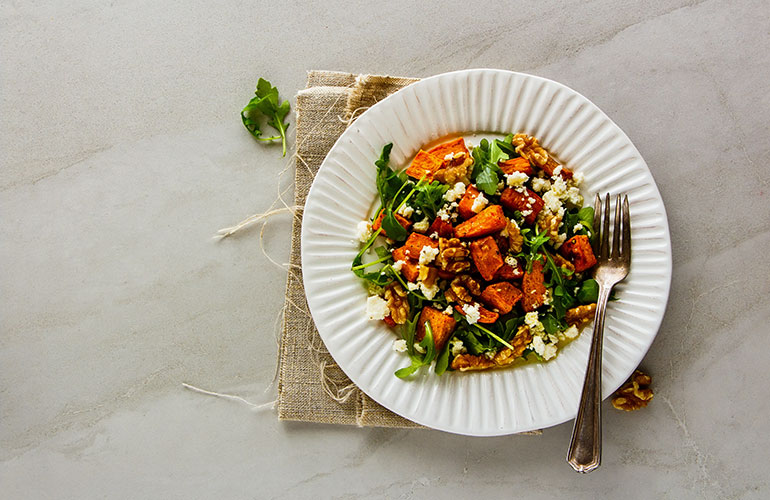 sweet potato salad on a bowl on a countertop